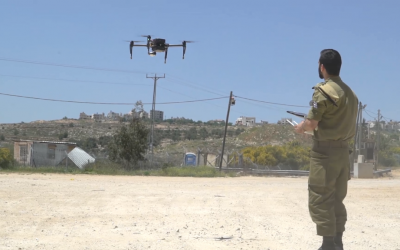A soldier in the IDF's Combat Intelligence Corps operates a new drone purchased by the military for company commander. (Screen capture: IDF Spokesperson's Unit)