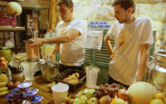 Health food company representatives prepare protein smoothies at a ShukTech event in Jerusalem, June 21, 2017. (Micah Danney/Times of Israel)