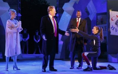 In this May 21, 2017, file photo provided by The Public Theater, Tina Benko, left, portrays Melania Trump in the role of Caesar's wife, Calpurnia, and Gregg Henry, center left, portrays President Donald Trump in the role of Julius Caesar during a dress rehearsal of The Public Theater's Free Shakespeare in the Park production of Julius Caesar in New York. (Joan Marcus/The Public Theater via AP)