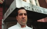 In this 1997 file photo, Al Yeganeh poses for a photograph outside his business, Soup Kitchen International, in New York. Yeganeh was the inspiration for the 'Soup Nazi' character on the US TV comedy 'Seinfeld.' (AP Photo/Michael Schmelling)