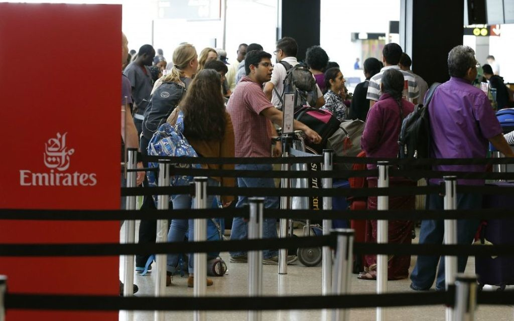 Travelers wait in line near an Emirates ticket counter at the Seattle-Tacoma International Airport, Monday, June 26, 2017, in Seattle, Washington. (AP Photo/Ted S. Warren)