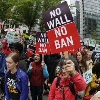 Protesters wave signs and chant during a demonstration against US President Donald Trump's revised travel ban, outside a federal courthouse in Seattle, on May 15, 2017. (AP/Ted S. Warren, File)