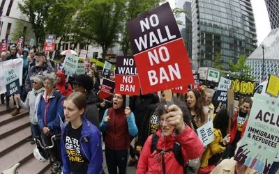 Illustrative: Protesters wave signs and chant during a demonstration against US President Donald Trump's revised travel ban, outside a federal courthouse in Seattle, on May 15, 2017. (AP/Ted S. Warren, File)