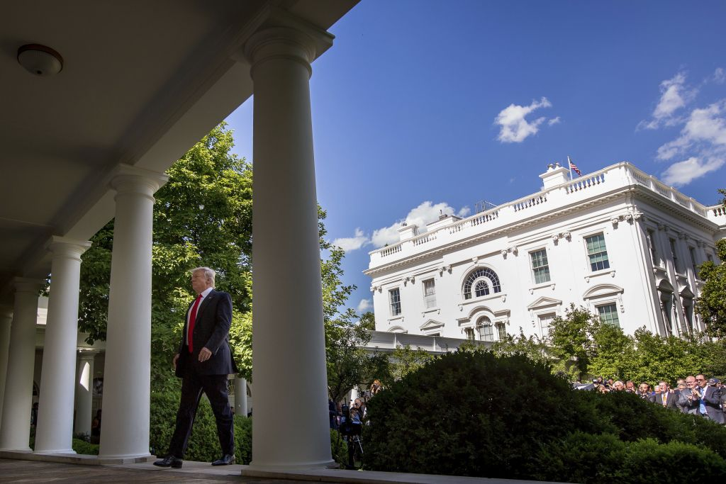 US President Donald Trump walks to the Oval Office of the White House in Washington, Thursday, June 1, 2017, after speaking in the Rose Garden about the US role in the Paris climate change accord. (AP Photo/Andrew Harnik)