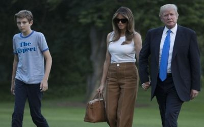 President Donald Trump, first lady Melania Trump and their son Barron Trump walk from Marine One across the South Lawn to the White House in Washington, June 11, 2017, as they return from Bedminster, N.J. (AP/Carolyn Kaster)