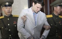 In this March 16, 2016, file photo, American student Otto Warmbier is escorted at the Supreme Court in Pyongyang, North Korea. Warmbier, whose parents say has been in a coma while serving a 15-year prison term in North Korea, was released and returned to the United States Tuesday, June 13, 2017, as the Trump administration revealed a rare exchange with the reclusive country. (AP Photo/Jon Chol Jin, File)