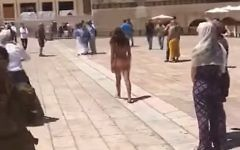 An Israeli woman streaks at the Western Wall in Jerusalem on Sunday, June 11, 2017 (screen capture: YouTube)