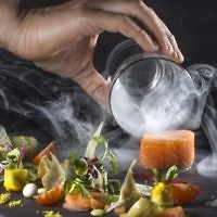 Salmon confit cannelloni, with smoke screen, cucumber tuna tartare, orange and radish cream, at the Palace Restaurant in Jerusalem's Waldorf Astoria Hotel. (Courtesy)