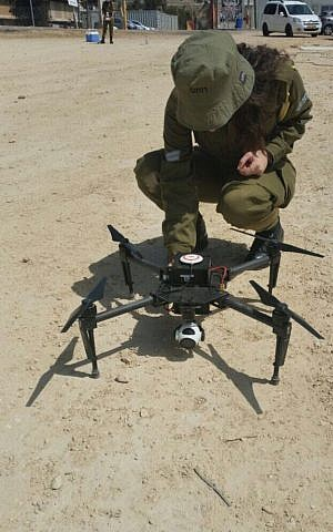 A soldier in the IDF's Combat Intelligence Corps inspects a new drone purchased by the military for company commander. (Screen capture: IDF Spokesperson's Unit)