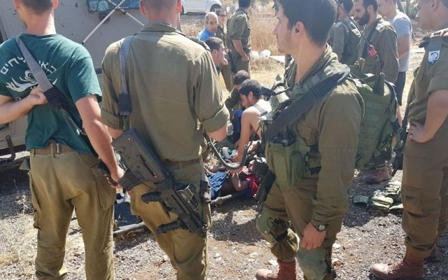 IDF medics treat a Palestinian woman who stabbed a soldier outside the Mevo Dotan settlement in the northern West Bank on June 1, 2017. (Samaria Regional Council)