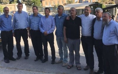 Settler leaders pose for a photo outside the Prime Minister's Office following their meeting with Benjamin Netanyahu on June 7, 2017. From R-L, Gush Etzion Regional Council Chairman Shlomo Ne'eman, Ma'ale Adumim Mayor Benny Kasriel, Beit El Local Council Chairman Shai Alon, Yesha Council Chairman Avi Roeh, Karnei Shomron mayor Yigal Lahav, Yesha Council Director General Shiloh Adler, Elkana Mayor Asaf Mintzer, and Kiryat Arba Local Council Head Malachi Levinger. (Jacob Magid/Times of Israel)
