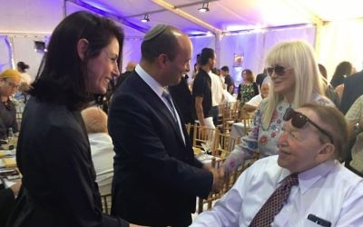 Education Minister Naftali Bennett with his wife Gilat and Sheldon Adelson and his wife Miriam at the cornerstone setting for The University of Ariel's new medical school, June 28, 2017. (Courtesy)