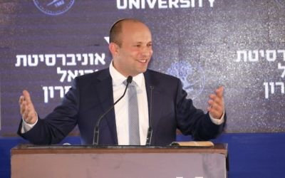 Education Minister Naftali Bennett speaks at the cornerstone setting for The University of Ariel's new medical school, June 28, 2017. (Michael Dimenson)