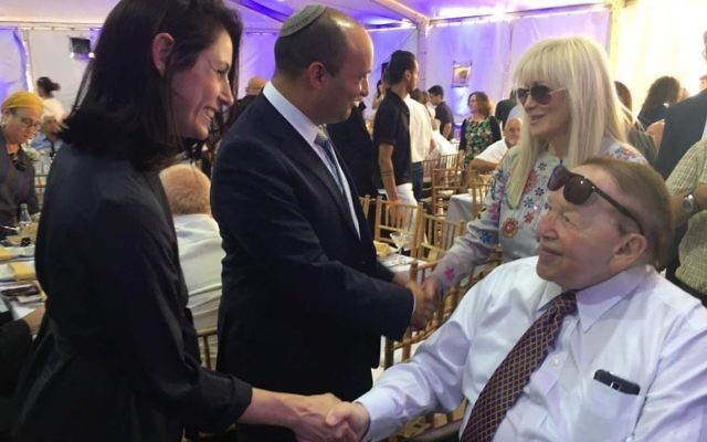 Minister of Education Naftali Bennett (C) with his wife Gilat greet Sheldon Adelson (R) and his wife Miriam at the cornerstone setting ceremony for the new school of medicine at Ariel University, June 28, 2017. (Courtesy)