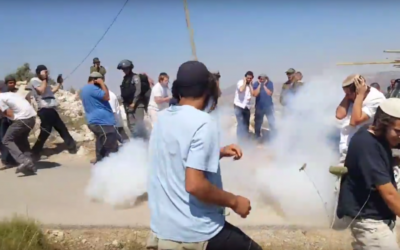 Residents of the West Bank settlement of Yitzhar clash with security forces during a demolition of an illegal structure on June 25, 2017. (Screen capture: YouTube)