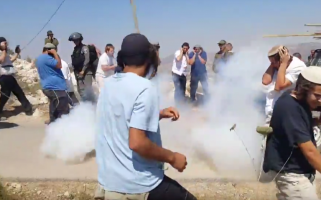Illustrative: Residents of the West Bank settlement of Yitzhar clash with security forces during a demolition of an illegal structure on June 25, 2017. (Screen capture: YouTube)