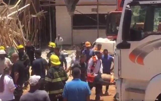 Illustrative image of emergency workers evacuating an injured laborer after a roof collapsed on a building site in Ganei Tikva, in central Israel, wounding four, one seriously. June 1, 2017. (Magen David Adom screenshot.)