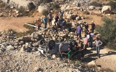 A Palestinian car veered off the road following a deadly crash with an Israeli vehicle on Route 60 in the West Bank, Friday, june 23, 2017. (MDA)