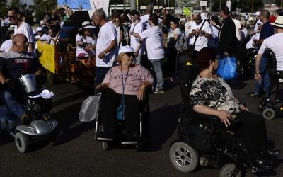Illustrative: Disabled and able-bodied activists attend a protest in Tel Aviv, June 13, 2017. (Tomer Neuberg/Flash90)