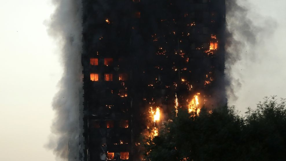 Smoke and flames rise from a building on fire in London, Wednesday, June 14, 2017. (AP Photo/Matt Dunham)