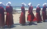 Handmaids at the beach in Tel Aviv, Israel, June 22, 2017. (Courtesy of HOT)