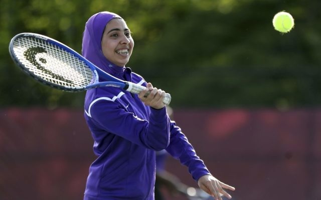 Tabarek Kadhim, a student at Deering High School in Portland, Maine, wears a sports hijab while playing a tennis match in Windham, Maine in 2017. (AP Photo/Robert F. Bukaty)