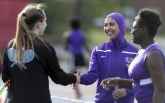 In this May 24, 2017 photo, Tabarek Kadhim, center, congratulates an opponent after a tennis match in Windham, Maine. (AP Photo/Robert F. Bukaty)
