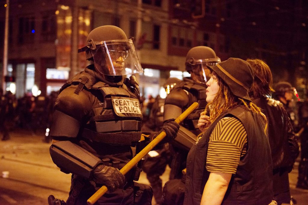 Illustrative: A woman faces off with a Seattle police officer on Capitol Hill during a May Day protest. (istockphotos)