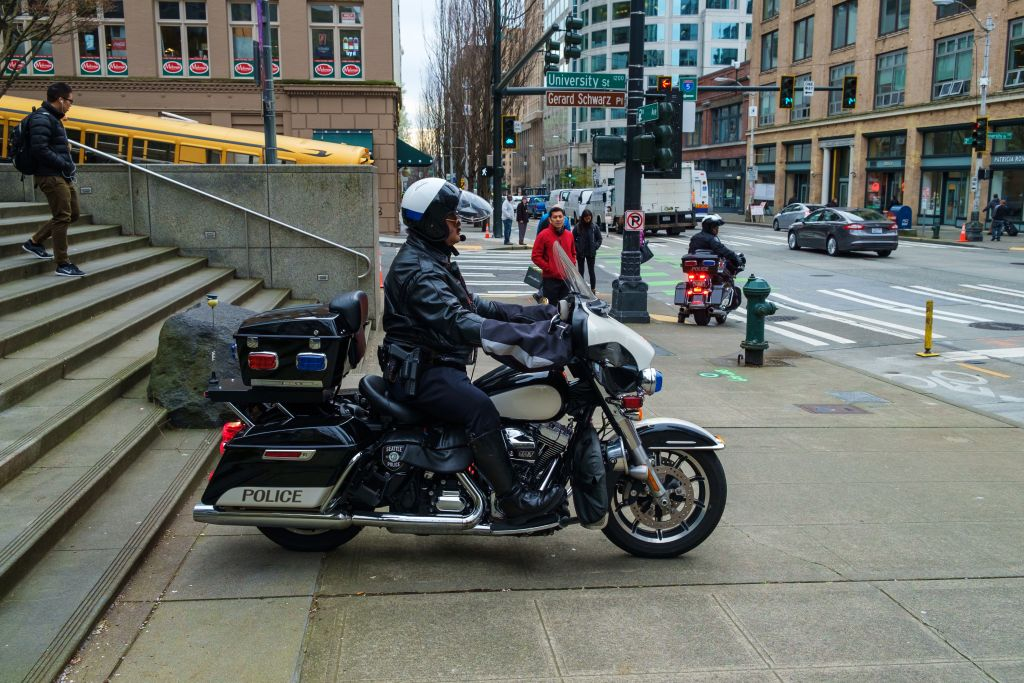 A Seattle motorcycle policeman on the sidewalk. (istock photos)