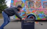"A screenshot from a music video showing a bus painted with Jewish symbols by Brooklyn artist Lev ""Leviticus"" Schieber."