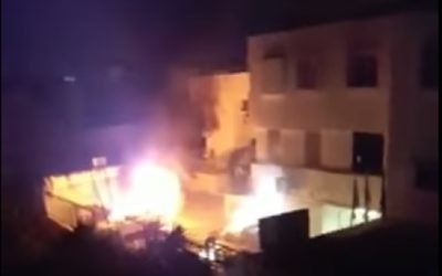 Police cars set on fire in Kafr Kassem on June 6, 2017. (screen capture: YouTube)