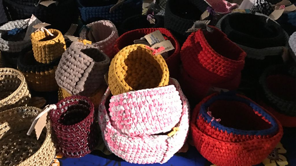 Baskets handwoven by members of the Kuchinate Collective for sale during Tel Aviv's White Night celebrations, June 29, 2017. (Luke Tress/Times of Israel)