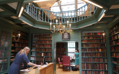 Staff preparing the Ets Haim Jewish library in Amsterdam for a tour, May 17, 2017. (Cnaan Liphshiz/JTA)