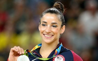 Silver medalist Aly Raisman celebrates on the podium at the medal ceremony for the Women's Floor on Day 11 of the Rio 2016 Olympic Games at the Rio Olympic Arena on August 16, 2016 in Rio de Janeiro, Brazil.  (Photo by Alex Livesey/Getty Images via JTA)