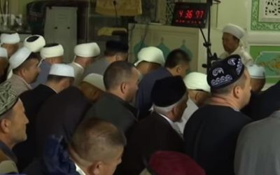 Muslims in China's Xinjiang province gather for prayers during Ramadan, May 2017. (Screen capture: YouTube)