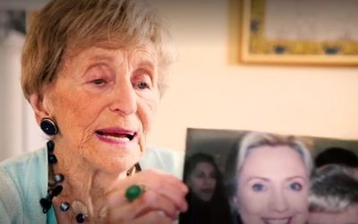 Sara Ehrman, who died aged 98, holding up a photograph of herself with Hillary Clinton, October 28, 2016. (New York Times screenshot)
