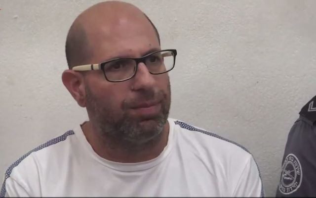 Shaul Shamai, accused of molesting 10 girls while acting as a substitute teacher in Tel Aviv, seen in Tel Aviv Magistrate's Court on June 13, 2017. (Screen capture: Ynet)