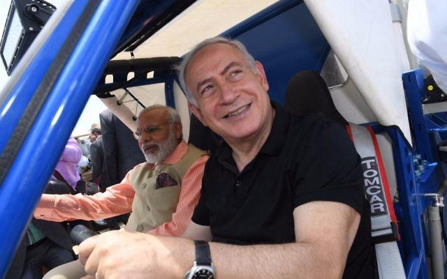 Benjamin Netanyahu, right, and Narendra Modi in a water purification buggy on Olga Beach on July 6, 2017. (Kobi Gideon/GPO)