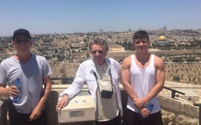 Frankie Valli (center) and his son (right) at the Haas Promenade overlooking Jerusalem's Old City (Courtesy Nidar Oz Communications)