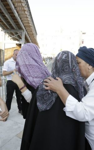Masked women interrupt the Women of the Wall prayer event at the Western Wall, on July 24, 2017. (Hila Shiloni)