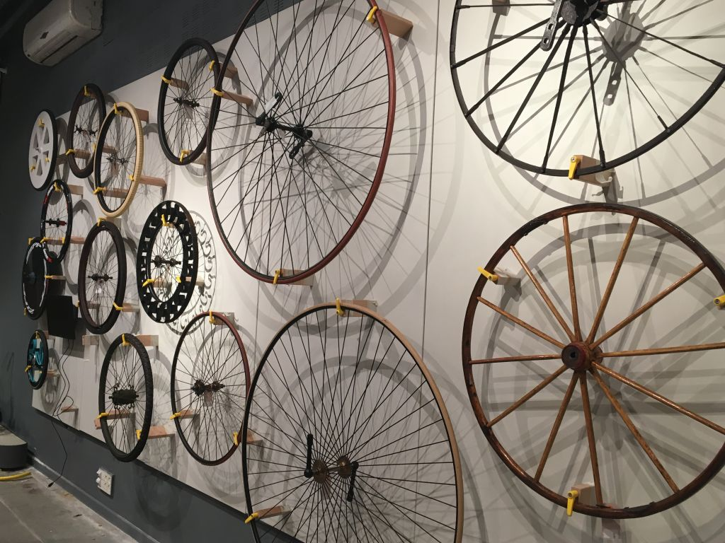 A wall of bike wheels at '2 x 200,' the new exhibit at the Bloomfield Science Museum (Courtesy Tal Barlev)