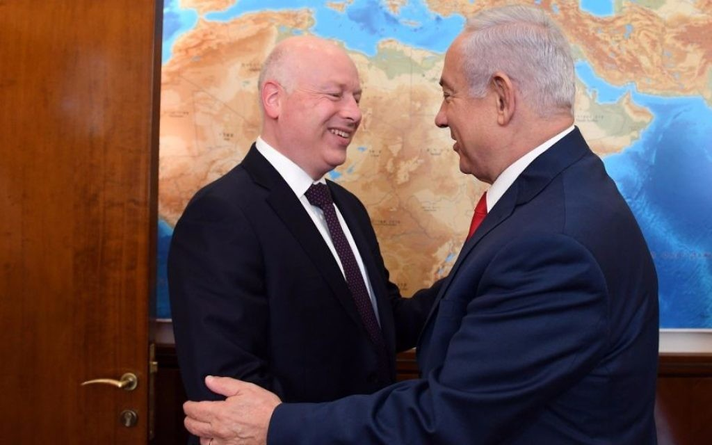 US President Donald Trump's envoy to the Middle East Jason Greenblatt, left, and Prime Minister Benjamin Netanyahu exchange greetings at the Prime Minister's Office in Jerusalem, July 12, 2017. (Haim Tzach/GPO)