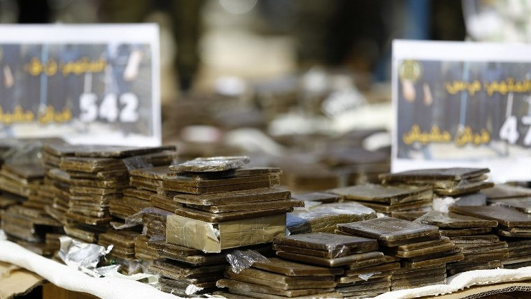 A pile of confiscated bars of hashish seized since the beginning of the year before they were burnt in Gaza City, on May 11, 2017. (AFP Photo/Mohammed Abed)