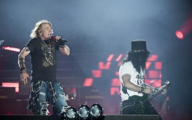 Axl Rose (L), lead singer of the rock band Guns N' Roses, performs with Slash at Parken Stadium, Copenhagen, Denmark, on June 27, 2017. (AFP/Mads Joakim Rimer Rasmussen)