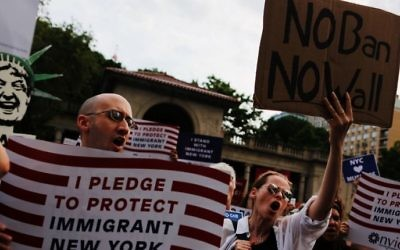 People take part in a rally to protest restrictive guidelines issued by the US on who qualifies as a close familial relationship under the Supreme Court order on the Muslim and refugee ban at Union Square on June 29, 2017, in New York. (AFP Photo/Eduardo Munoz Alvarez)
