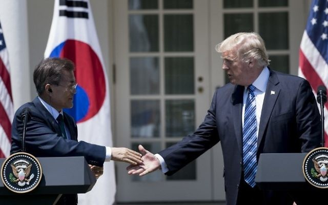South Korea's President Moon Jae-in and US President Donald Trump shake hands while making statements in the Rose Garden of the White House June 30, 2017 in Washington, DC. (AFP PHOTO / Brendan Smialowski)