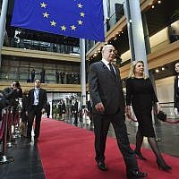 Prime Minister Benjamin Netanyahu and his wife Sara arrive at the European Parliament in Strasbourg, eastern France, on July 1, 2017 before a ceremony in tribute to former German chancellor Helmut Kohl. (AFP/Sebastien Bozon)