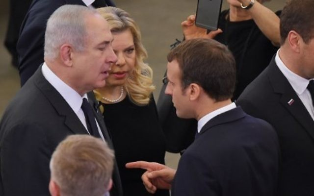 French President Emmanuel Macron (C) gestures as he speaks with Prime Minister Benjamin Netanyahu (L) and his wife Sara (rear L) at the European Parliament in Strasbourg, France, on July 1, 2017. (AFP Photo/Patrick Hertzog)