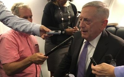 This file photo taken on June 27, 2017 shows US Secretary of Defense Jim Mattis speaking to reporters aboard a military jet as he heads to Europe. (Thomas Watkins/AFP)