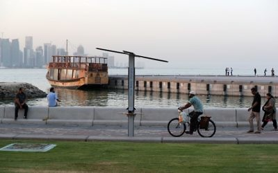 People walk on the corniche of the Qatari capital Doha on July 2, 2017. (AFP/ STR)